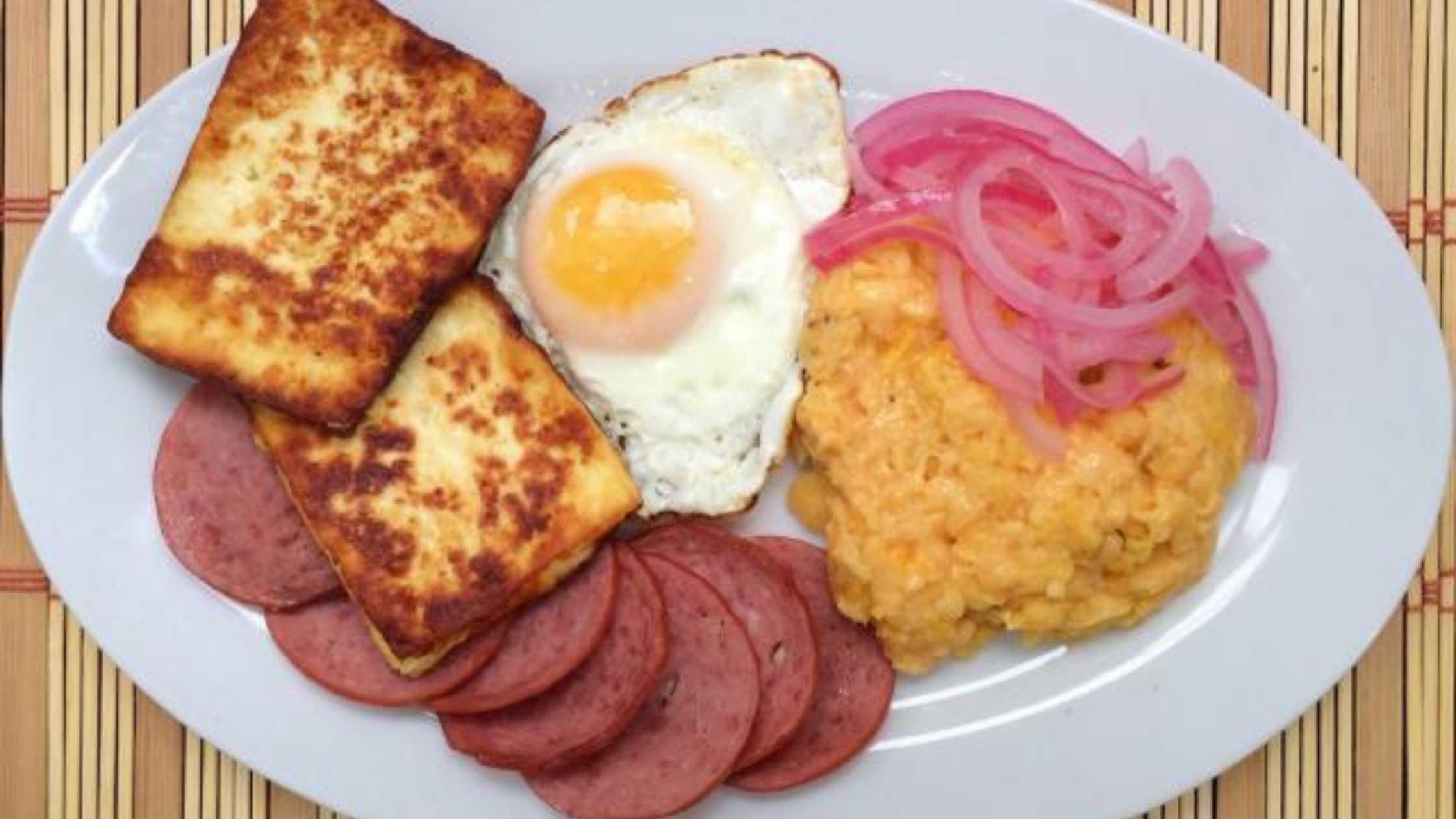 mangu dominicano on a white plate.