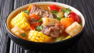 Sancocho soup dish in a black bowl