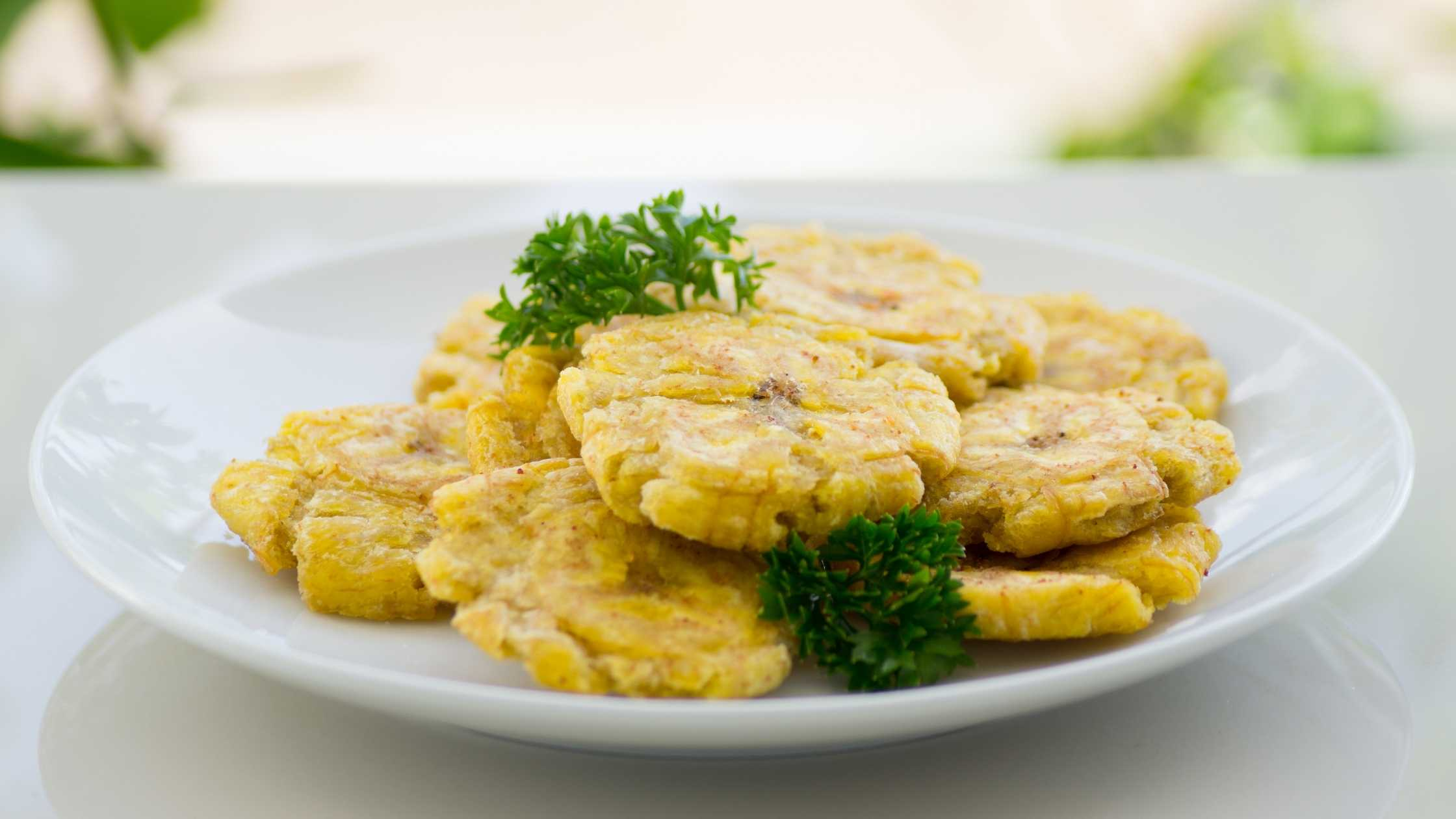 tostones fritos on a white plate